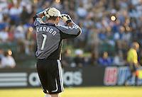 Joe Cannon puts on a baseball cap to block the sun in his eyes. San Jose 4, New England 0. Buck Shaw Stadium, Santa Clara, California. August 16th, 2008.