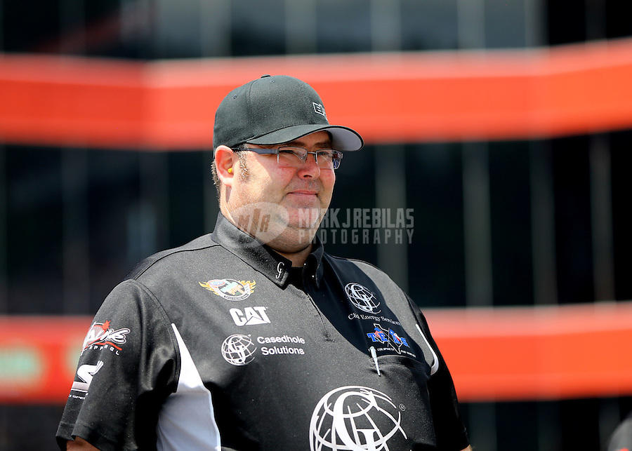 Jun 21, 2015; Bristol, TN, USA; Jason McCulloch , crew chief for NHRA top fuel driver Dave Connolly during the Thunder Valley Nationals at Bristol Dragway. Mandatory Credit: Mark J. Rebilas-