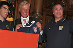 07 June 2006: United States head coach Bruce Arena (USA) (r) and player captain Claudio Reyna (USA) (l) present a personalized team jersey to Hamburg mayor Ole von Beust. The United States Men's National Team was honored at City Hall, the Rathaus, in Hamburg, Germany, where the team is based out of for the FIFA 2006 World Cup tournament.
