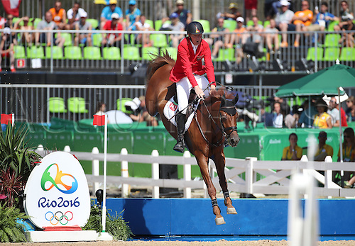 14.08.2016. Rio de Janeiro, Brazil. Ludger Beerbaum of Germany on horse Casello clears an obstacle during the Jumping Team 1st Qualifier of the Equestrian competition at the Olympic Equestrian Centre during the Rio 2016 Olympic Games in Rio de Janeiro, Brazil, 14 August 2016.