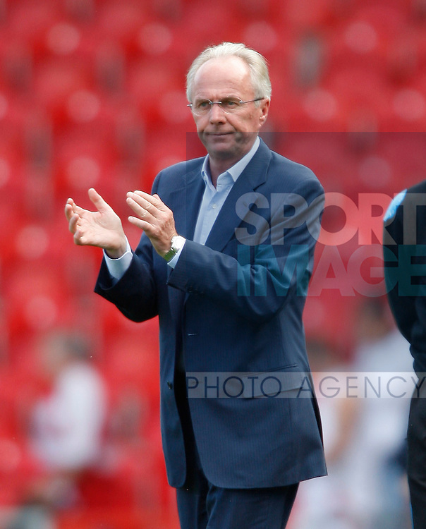 Sven Goran Eriksson applauds the traveling fans