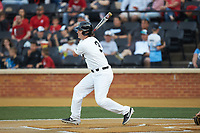 Bobby Seymour (3) of the Wake Forest Demon Deacons follows through on his swing against the North Carolina State Wolfpack at David F. Couch Ballpark on April 18, 2019 in  Winston-Salem, North Carolina. The Demon Deacons defeated the Wolfpack 7-3. (Brian Westerholt/Four Seam Images)