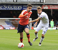 Alex Gillead of Luton Town gets away from Kevan Hurst during the Sky Bet League 2 match between Luton Town and Mansfield Town at Kenilworth Road, Luton, England on 22 October 2016. Photo by Liam Smith.
