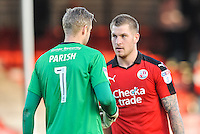 James Collins of Crawley Town (19) and Elliott Parish of Accrington Stanley (1) at the end of the game  during the Sky Bet League 2 match between Crawley Town and Accrington Stanley at Broadfield Stadium, Crawley, England on 22 October 2016. Photo by Edward Thomas / PRiME Media Images.