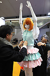 "January 16, 2019, Tokyo, Japan - Japanese robot venture Speecys employees put clothes on a life-sized mannequin robot ""Kosoka Cocona"" which has 37 actuators and make various posing and dancing at an robot exhibition Robodex in Tokyo on Wednesday, January 16, 2019. Some 220 robot companies display their recent products and technlogies at a three-day exhibition.   (Photo by Yoshio Tsunoda/AFLO) LWX -ytd"