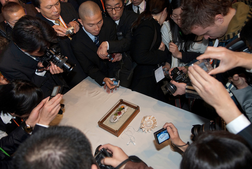 Audience members photograph a creation by chef Heston Blumenthal at Tokyo Taste, The World Summit of Gastronomy 2009, 10 February 2009,Tokyo, Japan. The sea-shell contains an ipod.Many of the world's top chefs are assembled for the sold-out 3 day event in the center of Tokyo.