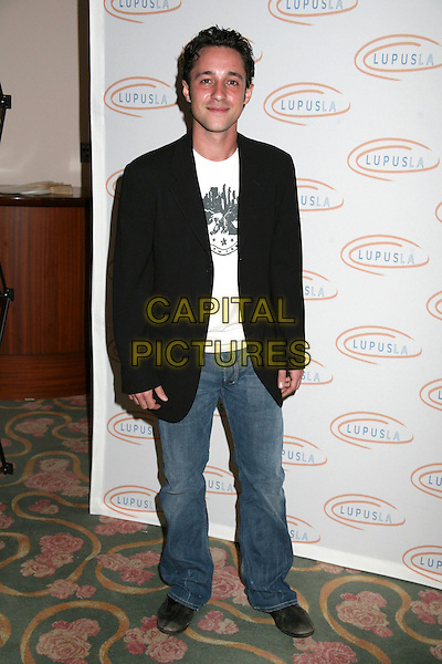 """THOMAS IAN NICHOLAS.Lupus LA's """"Evening of Love, Light and Laughter"""" at the Beverly Hills Hotel. Los Angeles Premiere of """"Keeping Up With The Steins"""", Beverly Hills, California, USA..May 11th, 2006.Photo: Byron Purvis/AdMedia/Capital Pictures.Ref: BP/ADM.full length black suit jacket jeans denim.www.capitalpictures.com.sales@capitalpictures.com.© Capital Pictures."""