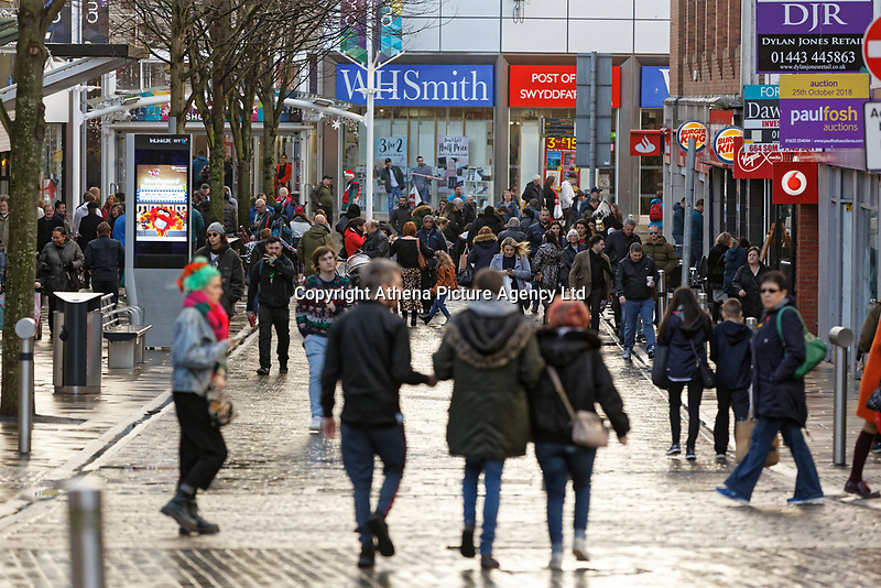 Last minute Christmas shoppers on the junction of Union and Oxford Streets, in Swansea, Wales, UK. Saturday 22 December 2018