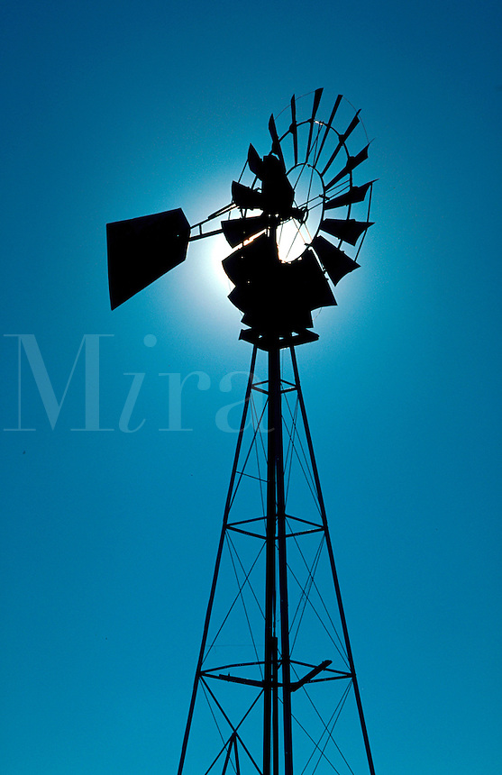 Windmill in silhouettes.