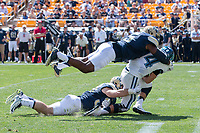 Pitt Panther defensive end Ejuan Price and linebacker Mike Caprara sack the quarterback. The Pitt Panthers defeated the Villanova Wildcats 28-7 at Heinz Field, Pittsburgh, Pennsylvania on September 3, 2016.