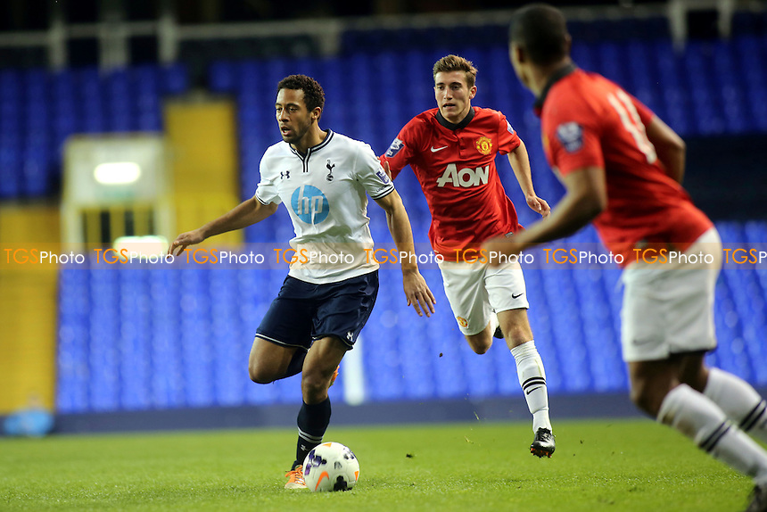 Mousa Dembele of Tottenham takes on the Manchester United defence - Tottenham Hotspur Under-21 vs Manchester United Under-21 - Barclays Under-21 Premier League Football at White Hart Lane - 14/04/14 - MANDATORY CREDIT: Paul Dennis/TGSPHOTO - Self billing applies where appropriate - 0845 094 6026 - contact@tgsphoto.co.uk - NO UNPAID USE