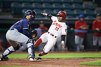 Altoona Curve center fielder Elvis Escobar (13) slides home behind catcher Mike Reeves (3) during a game against the New Hampshire Fisher Cats on May 11, 2017 at Peoples Natural Gas Field in Altoona, Pennsylvania.  Altoona defeated New Hampshire 4-3.  (Mike Janes/Four Seam Images)