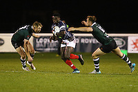 Matt Williams of London Scottish (centre) evades the Nottingham Rugby challenge during the Greene King IPA Championship match between London Scottish Football Club and Nottingham Rugby at Richmond Athletic Ground, Richmond, United Kingdom on 16 October 2015. Photo by David Horn.