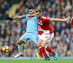 Sergio Aguero of Manchester City tussles with Calum Chambers of Middlesbrough during the Premier League match at the Etihad Stadium, Manchester. Picture date: November 5th, 2016. Pic Simon Bellis/Sportimage