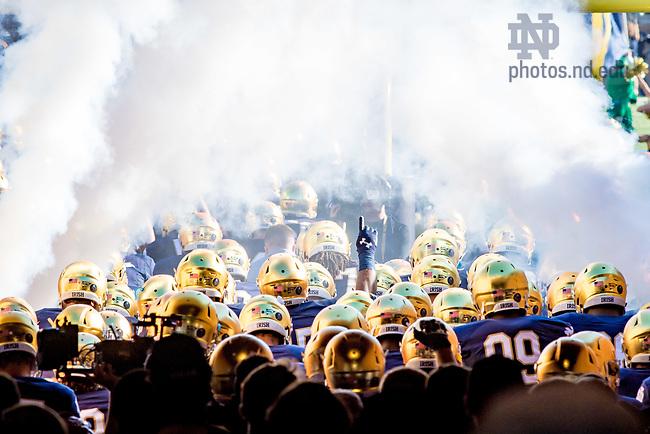 September 30, 2017; The Football team takes the field. (Photo by Matt Cashore/University of Notre Dame)
