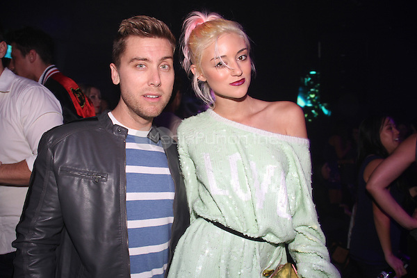 HOLLYWOOD, CA - JANUARY 24: Caroline D'Amore, Lance Bass attends the OK! Magazine pre-Grammy party at Lure Nightclub on January 24, 2014 in Hollywood, California. Credit: Walik Goshorn/MediaPunch