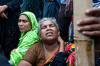A woman mourns for her missing relatives. 4 members of her family missing.  The Pinak-6, a passenger vessel sank in the middle of the river Padma on its way to Mawa from Kawrakandi terminal at around 11 PM today. The boat capsized since the river was rough due to the stormy weather. At least 250 people were in the capsized boat. Local people rescued nearly 45 passengers from the river and many other are still missing. Stormy weather and strong current hamper the rescue operation. Mawa, Munshigonj, near Dhaka, Bangladesh