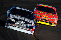 Apr 11, 2008; Avondale, AZ, USA; NASCAR Sprint Cup Series driver Dale Earnhardt Jr leads Kevin Harvick during practice for the Subway Fresh Fit 500 at Phoenix International Raceway. Mandatory Credit: Mark J. Rebilas-