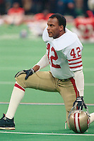 NEW ORLEANS, LA - Ronnie Lott of the San Francisco 49ers kneels on the field before Super Bowl XXIV against the Denver Broncos at the Superdome in New Orleans, Louisiana on January 28, 1990. Photo by Brad Mangin.