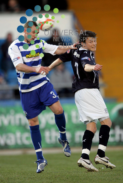 Kevin McKinlay takes on Nicky Riley during the Morton v Dundee at Cappielow Park,Greenock..Picture: Universal News And Sport (Scotland).  7 December  2010..