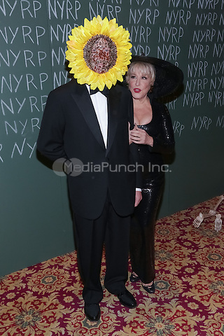 """NEW YORK, NY - OCTOBER 31 : Max Von Haselberg (L) and Singer/Actress Bette Midler arrive for the New York Restoration Project's 19th Annual Hulaween Gala """"FELLINI HULAWEENI"""" held at the Waldorf Astoria on October 31, 2014 in New York City.  (Photo by Brent N. Clarke / MediaPunch)"""