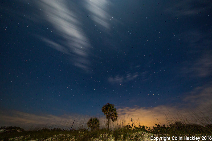 CAPE SAN BLAS, FLA. 4/15/16-Moonlight and starlight and passing clouds mix in the sky above the of beach T. H. Stone Memorial St. Joseph Peninsula State Park on Cape San Blas, Fla.<br />