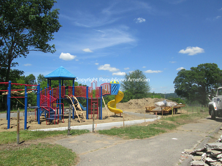 WATERBURY,CT- 29 May 2015-052915DL02-- A new playground set was placed in the upper area of Chase Park on Monday. The playground and a new sprinkler area is expected to be complete midsummer. Destiny Lopez Republican-American