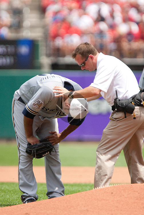 July 4, 2010          Brewers trainer Dan Wright (right) checks out Milwaukee Brewers starting pitcher Yovani Gallardo (49) after it appeared that Gallardo pulled a muscle while pitching.  He was relieved by Milwaukee Brewers relief pitcher Carlos Villanueva in the bottom of the third inning.  The St. Louis Cardinals defeated the Milwaukee Brewers 7-1 in the final game of a four-game homestand at Busch Stadium in downtown St. Louis, MO on Sunday July 4, 2010.