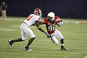 January 5th, 2008:  Ball State wide receiver Dante Love (86) stiff arms Rutgers defender Devin McCourty (21) during the third quarter of the International Bowl at the Rogers Centre in Toronto, Ontario Canada...Rutgers defeated Ball State 52-30.  ..Photo By:  Mike Janes Photography