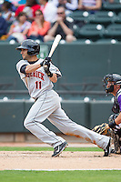 Jason Esposito (11) of the Frederick Keys follows through on his swing against the Winston-Salem Dash at BB&T Ballpark on May 18, 2014 in Winston-Salem, North Carolina.  The Dash defeated the Keys 7-6.  (Brian Westerholt/Four Seam Images)