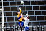 St Mary's Niall O'Driscoll goes one on one with the Carrigaline keeper.