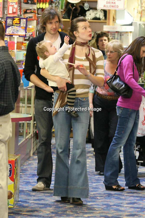 ..11-29-08.Saturday  Exclusive.Milla Jovovich shopping with her baby Ever Gabo  at Toms Toys in Beverly Hills ca with Grandma and director Paul Anderson.  They bought a stuffed teddy bear and some candy. Then they went to eat at Johnny Rockets. ...AbilityFilms@yahoo.com.805-427-3519.www.AbilityFilms.com