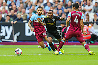 Ryan Fredericks of West Ham United, Raheem Sterling of Manchester City and Ryan Fredericks of West Ham United during the Premier League match between West Ham United and Manchester City at the London Stadium, London, England on 10 August 2019. Photo by David Horn.