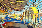 Cradle of Aviation air and space museum, seen from 3rd floor of atrium lobby with F11 jet, biplane, astronaut in space walk suit, in Garden City, New York, USA, on December 2, 2011