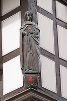 statue in carved wood of a nun andlau alsace france