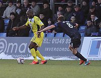 Isaac Osbourne being watched by Richie Brittain in the Ross County v St Mirren Scottish Professional Football League match played at the Global Energy Stadium, Dingwall on 17.1.15.