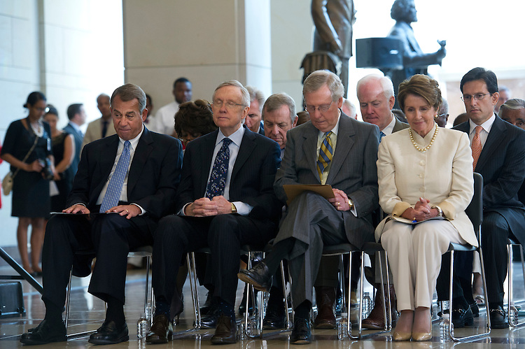 UNITED STATES - July 18: Speaker of the House John Boehner, R-OH., Rep. Maxine Waters, D-GA., Senate Minority Majority Leader Harry Reid, D-NV., Sen. Richard Durbin, D-IL., Senate Minority Leader Mitch McConnell, R-KY., Sen. John Cornyn, R-TX., House Minority Leader Nancy Pelosi, D-CA., and House Majority Leader Eric Cantor, R-VA., during an event in Capitol Visitor Center Emancipation Hall to honor Nelson Mandela and to celebrate his birthday on July 18, 2013. (Photo By Douglas Graham/CQ Roll Call)