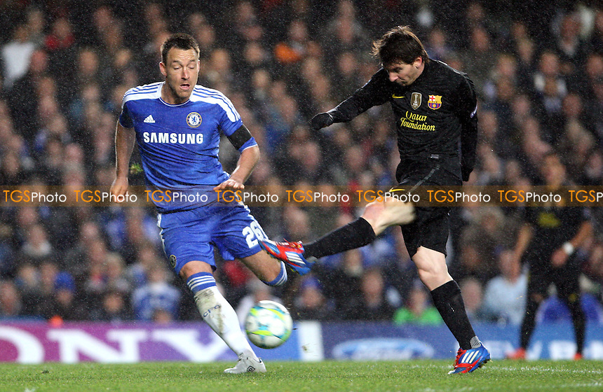 Lionel Messi of Barcelona gets in a 1st half shot ahead of John Terry of Chelsea - Chelsea vs Barcelona, Champions League Semi-Final 1st Leg at Stamford Bridge, Chelsea - 18/04/12 - MANDATORY CREDIT: Rob Newell/TGSPHOTO - Self billing applies where appropriate - 0845 094 6026 - contact@tgsphoto.co.uk - NO UNPAID USE..
