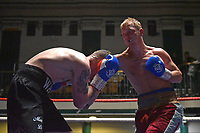 Jimmy Smith (red shorts) defeats Bryn Wain during a Boxing Show at York Hall on 30th November 2018