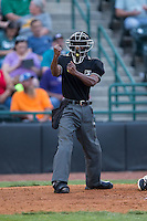 Home plate umpire Darrell Roberts makes a strike call during the South Atlantic League between the Lexington Legends and the Hickory Crawdads at L.P. Frans Stadium on April 29, 2016 in Hickory, North Carolina.  The Crawdads defeated the Legends 6-2.  (Brian Westerholt/Four Seam Images)