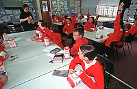 Schoolchildren with their teacher taking part in a science lesson. This image may only be used to portray the subject in a positive manner..©shoutpictures.com..john@shoutpictures.com