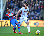 Patrick van Aanholt of Crystal Palace tackled by Sander Berge of Sheffield Utd during the Premier League match at Selhurst Park, London. Picture date: 1st February 2020. Picture credit should read: Paul Terry/Sportimage