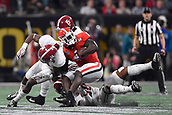 January 8th 2018, Atlanta, GA, USA; Georgia Bulldogs running back Sony Michel (1) battles with Alabama Crimson Tide defensive back Deionte Thompson (14) and Alabama Crimson Tide linebacker Mack Wilson (30) during the College Football Playoff National Championship Game between the Alabama Crimson Tide and the Georgia Bulldogs on January 8, 2018 at Mercedes-Benz Stadium in Atlanta, GA.