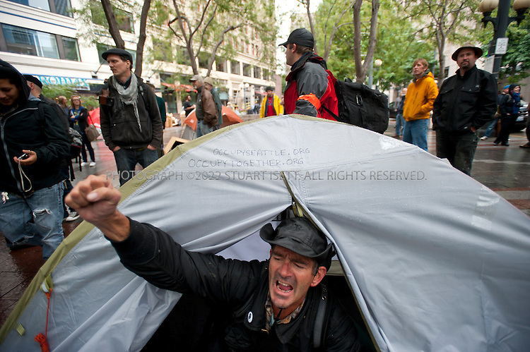 """10/5/2011--Seattle, WA, USA..The Seattle Police Department today arrested numerous Occupy Seattle protesters who had set up tents in Westlake Park in the heart of the city. After ordering protesters to remove the tents, police arrested those who refused to remove their them from the public park. Over 100 protesters were at the event, an offshoot of the Occupy Wall Street  and """"99-1"""" protest that is ongoing in New York City. ...©2011 Stuart Isett. All rights reserved"""