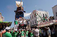 Brooklyn New York - 13 July 2008 - With confetti falling from above, a Capo leads the boat up Havameyer Street where it will, eventually, meet the Giglio. 120 Italian American men, adorned in the colors of the Italian Flag, carry the Giglio, and a similarly size boat, through the streets of WIlliamsburg, Brooklyn.  The Giglio and the boat meet, at the intersection of Havemeyer and North 8th Street to mark the Feast Day of fifth Century Saint Paulino, of Nola Italy.