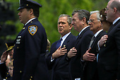 United States President George W. Bush, center, US Attorney General John Ashcroft, 2nd right, US Treasury Secretary Paul O'Neill, 3rd right, and US Secretary of Labor Elaine Chao, right, listen as New York Police Officer Daniel Rodriguez, left, sings the US National Anthem at the start of the 20th Annual Peace Officers Memorial Service, which pays tribute to fallen law enforcement officers 15 May 2001 on the lawn of the US Capitol. More than 150 US police officers were killed in the line of duty last year.  <br /> Credit: Jamal A. Wilson / Pool via CNP