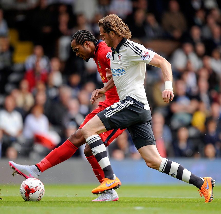 Blackburn Rovers' Nathan Delfouneso fires in a shot despite the attentions of Fulham's Richard Stearman<br /> <br /> Photographer Ashley Western/CameraSport<br /> <br /> Football - The Football League Sky Bet Championship - Fulham v Blackburn Rovers - Sunday 13th September 2015 - Craven Cottage<br /> <br /> &copy; CameraSport - 43 Linden Ave. Countesthorpe. Leicester. England. LE8 5PG - Tel: +44 (0) 116 277 4147 - admin@camerasport.com - www.camerasport.com