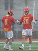 Frank Marinello #29, Chaminade defenseman, right, and goalie Andrew Bonafede #6 celebrate after a goal scored by the offense in a non-league varsity boys lacrosse game against host Massapequa High School on on Wednesday, April 4, 2018. Chaminade won by a score of 8-5.