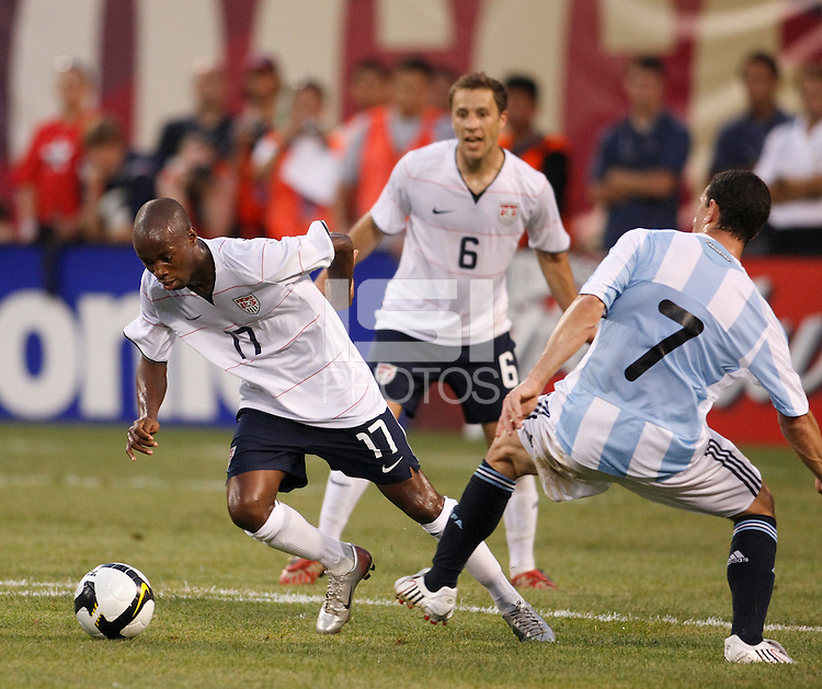 United States midfielder DaMarcus Beasley (17) and Argentina midfielder Maximiliano Rodriguez (7). The men's national teams of the United States and Argentina played to a 0-0 tie during an international friendly at Giants Stadium in East Rutherford, NJ, on June 8, 2008.