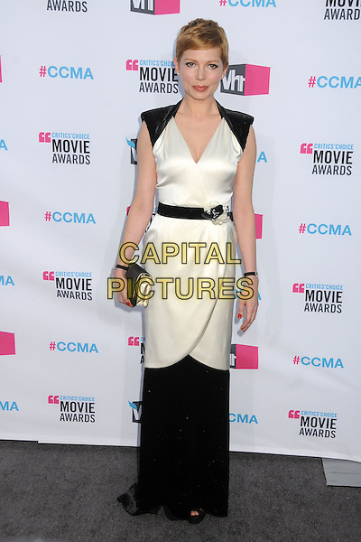 Michelle Williams.17th Annual Critics Choice Movie Awards - Arrivals held at the Hollywood Palladium,  Los Angeles, California, USA, 12th January 2012..arrivals full length black shoulder pads white dress  belt silk satin wrap  clutch bag .CAP/ADM/BP.©Byron Purvis/AdMedia/Capital Pictures.